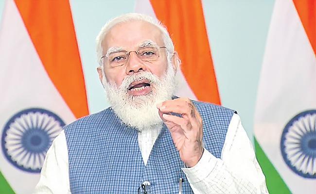 PM Modi Declares His Assets Slightly Richer Than Last Year - Sakshi