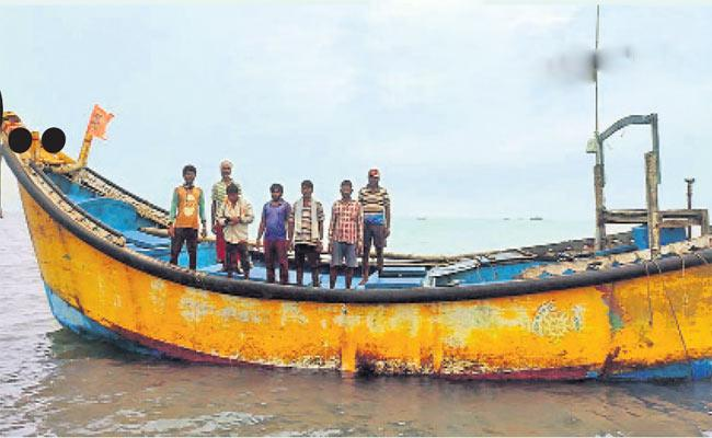 Fishermen Stuck In Sea Rescued By The Help Of Boat Sail - Sakshi