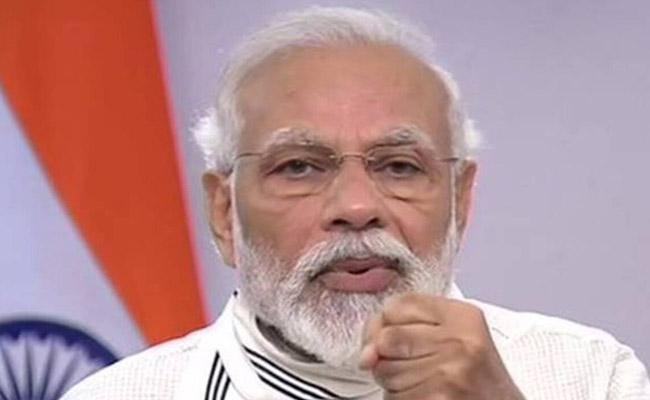 Covid vaccine delivery system on the lines of conduct of elections: PM Modi - Sakshi