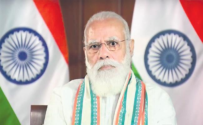 PM Narendra Modi Suggests Developing Vaccine Delivery System - Sakshi