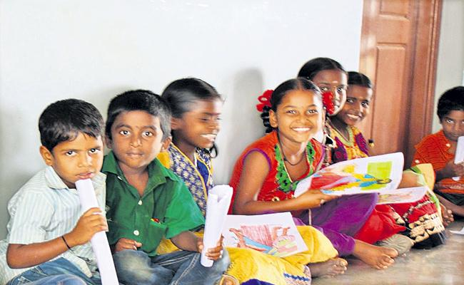 AP Government efforts to increase literacy of Tribal Students - Sakshi