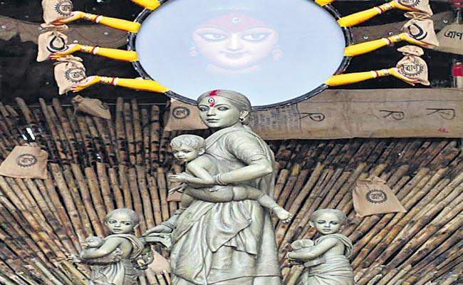 Statue Of Durga Mata In Form Of Migrant Working Woman - Sakshi