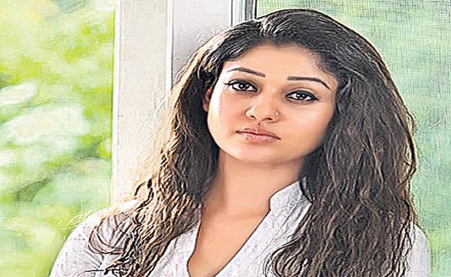Nayanthara to star opposite Kunchacko Boban in Nizhal - Sakshi