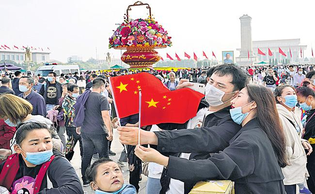 Millions on the move for Golden Week in China - Sakshi