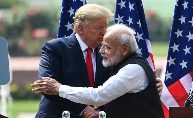 PM Modi wishes Donald and Melania Trump from corona - Sakshi