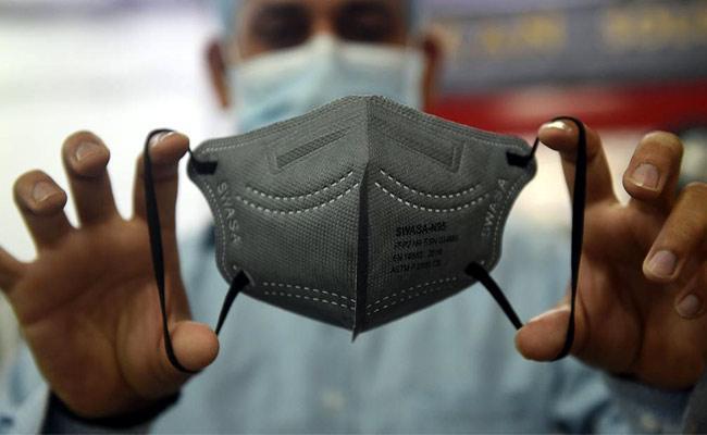 Coronavirus Face Masks Creating Waste Problem - Sakshi