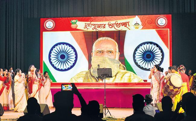 PM Narendra Modi attends commencement of Durga Puja celebrations - Sakshi