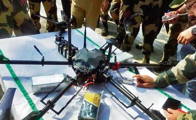 Security Forces Shoot Sown Pakistan Armys China-made Quadcopter  - Sakshi
