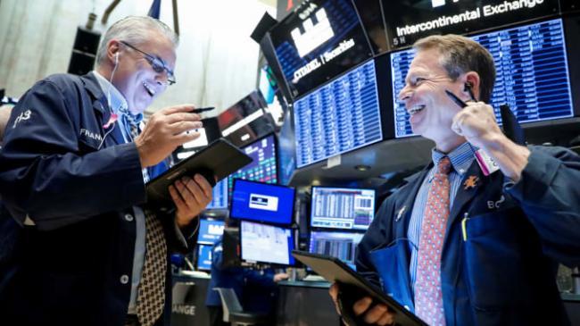 US Market up despite uncertainty on Stimulus - Sakshi