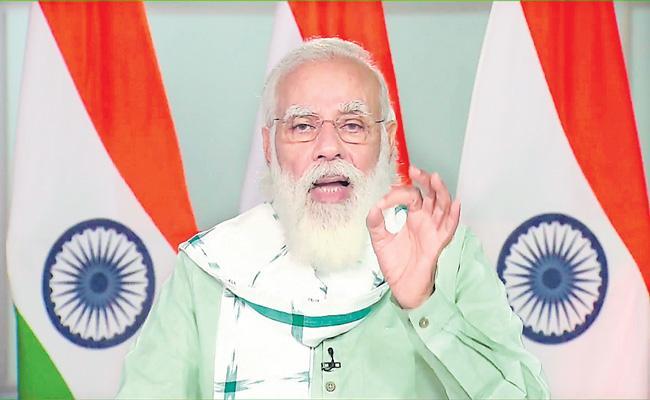 PM Narendra Modi inaugurates three development projects - Sakshi
