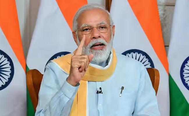 PM Says India Saved Huge Amount Through Use Of Renewable Energy - Sakshi