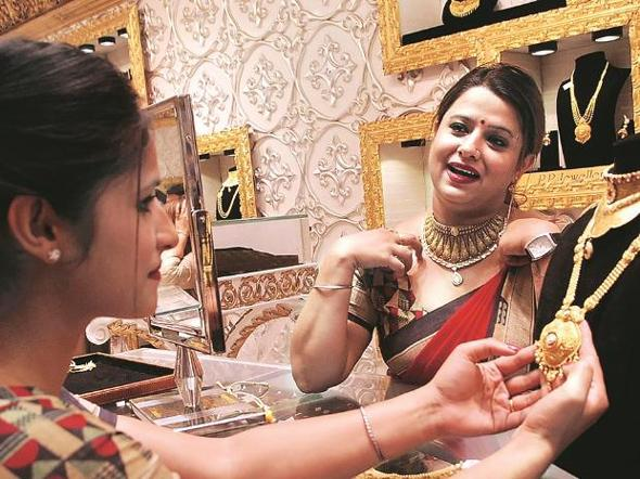 Gold Declines Amid Tepid Demand - Sakshi