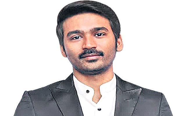 Dhanush selected for the Muttiah Muralitharan biopic - Sakshi