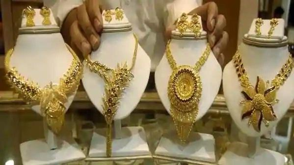 Gold, Silver prices weaken in MCX, Comex on Covid-19 fears  - Sakshi