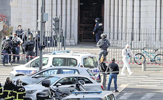 Three dead as woman beheaded in knife attack at French church - Sakshi