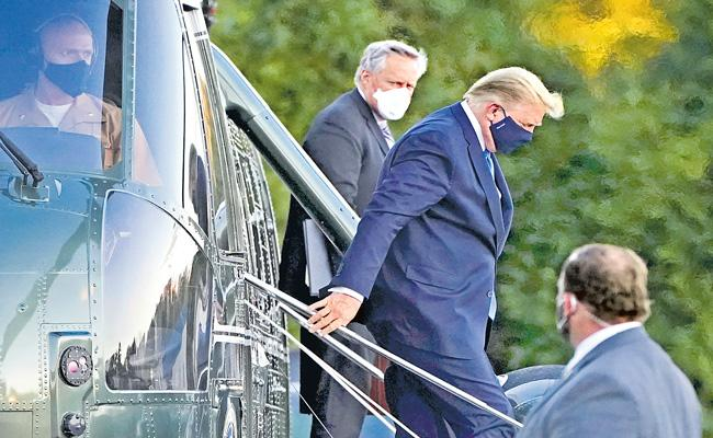 Donald Trump moved to military hospital after testing coronavirus positive - Sakshi