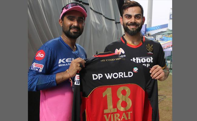 Virat Kohli Gifted A Special Autographed Jersey To Rahul Tewatia - Sakshi