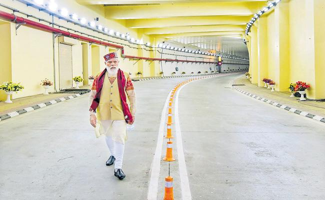 PM Narendra Modi inaugurates world longest highway tunnel - Sakshi