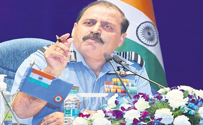 Prepared for two-front war Says IAF Chief Bhadauria - Sakshi