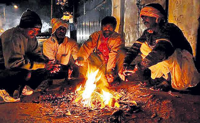 Night temperatures in the state recorded 2 to 5 degrees lower - Sakshi