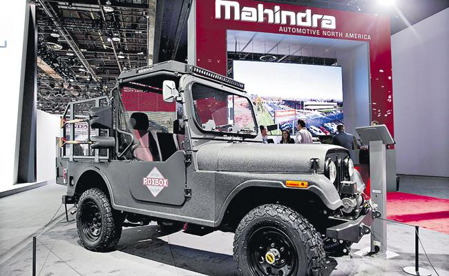 Mahindra profit 88 percent down - Sakshi