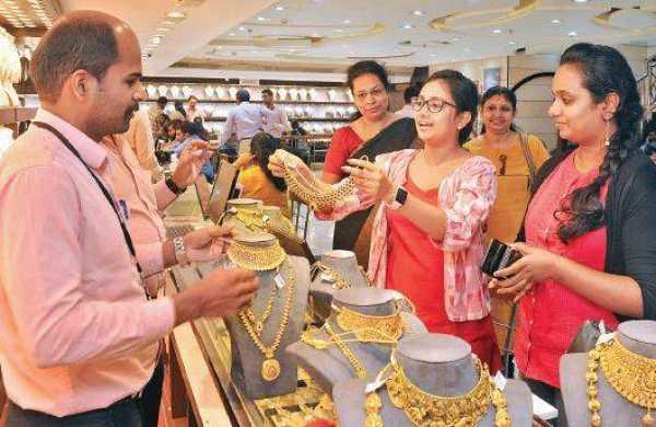 Gold Prices Edged Higher - Sakshi