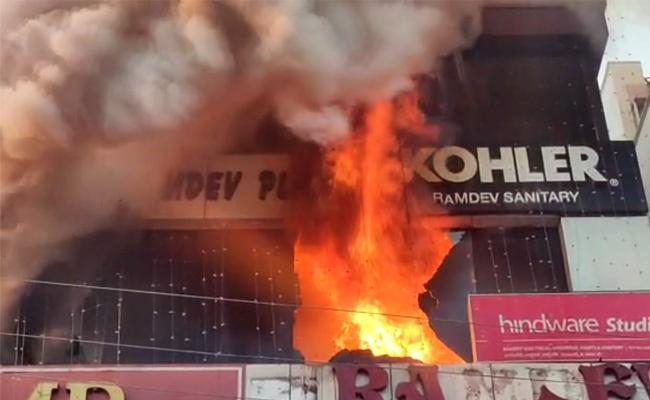 Fire Accident In Ramdev Electrical And Hardware Shop At KPHB Colony - Sakshi
