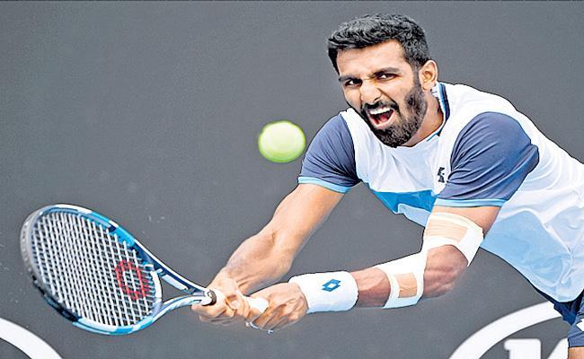Prajnesh Gunneswaran enters second round - Sakshi