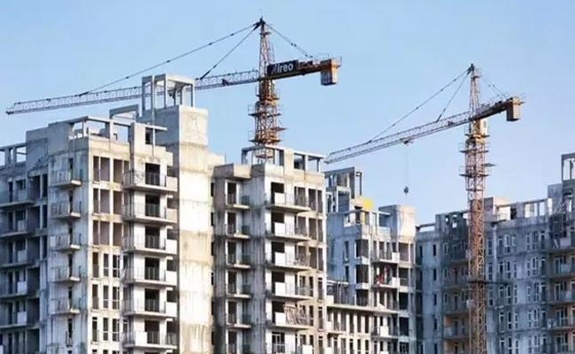 Realty shares jumps on recovery hopes, low interest rates - Sakshi