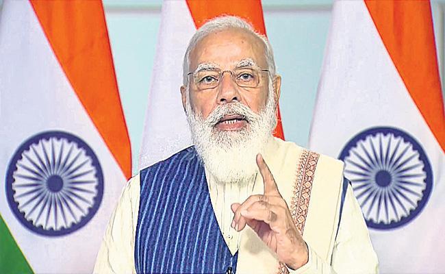 PM Narendra Modi calls for global solutions at Bengaluru tech event - Sakshi