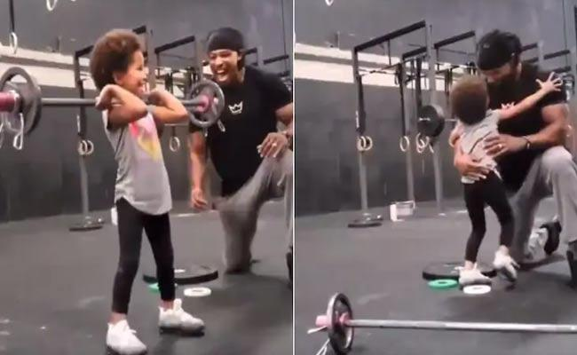Girl Lifts Weights As Dad Encourages Her In Viral Video - Sakshi