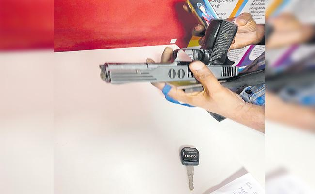 RGIA Police Arrested A Man Who Threatening With An Air Gun - Sakshi
