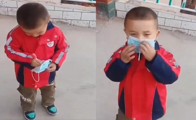 Viaral Video Of Small Boy Wears Mask With Eating Lollipop - Sakshi