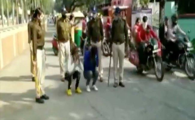 Video: Two Held For Harassing Women In MP Squats On Busy Road - Sakshi