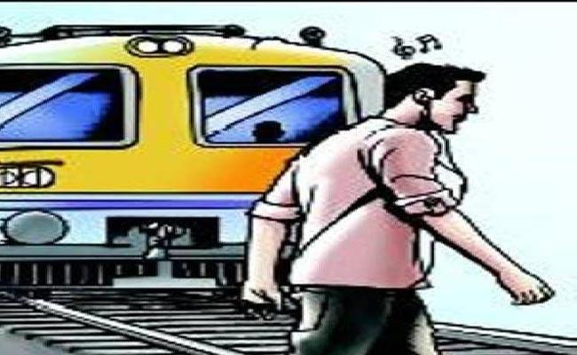 Train Crushes Young Man Crossing Tracks With Ear Phones Plugged In - Sakshi