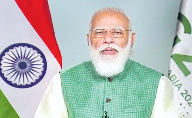 PM Narendra Modi G20 Summit Climate change must be fought not in silos but in integrated - Sakshi