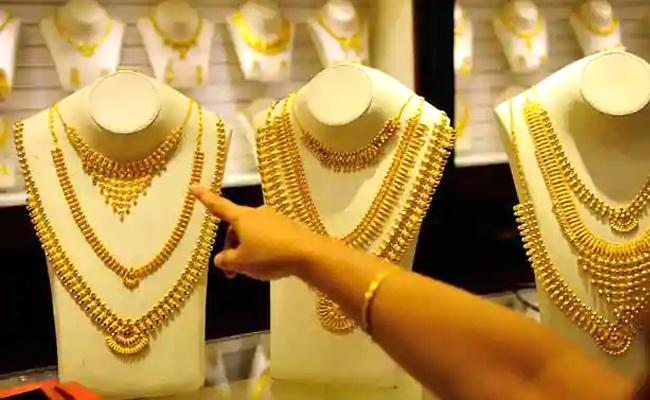 Gold, Silver rises second consecutive day in MCX - Sakshi