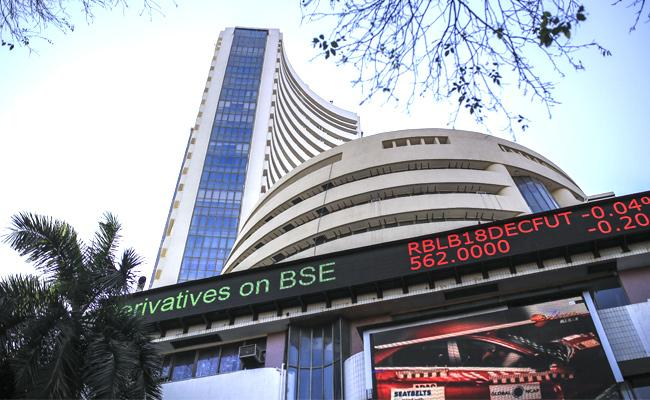 Nifty hits 13,000 points mark first time in market history - Sakshi