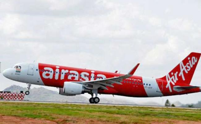 Tata group may invest in AirAsia through equity, debt - Sakshi