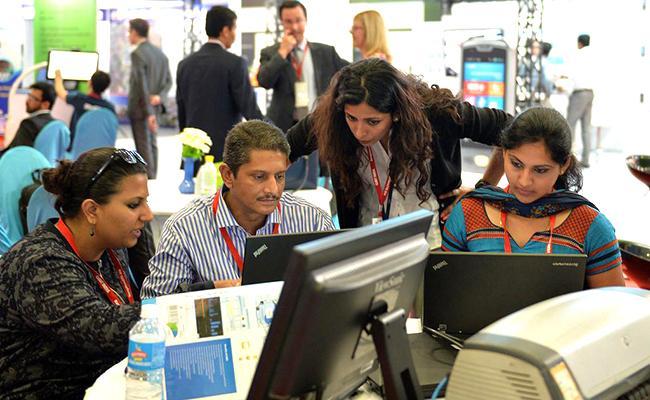 Indian IT Firms Ramp Up Hiring - Sakshi
