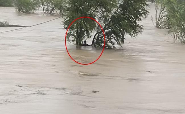 3 Farmers Stuck In Water Renigunta Yerpedu Rescue Operations On - Sakshi