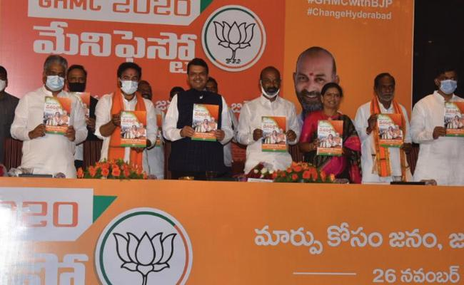 BJP Offer Free Corona Vaccine In GHMC Elections 2020 - Sakshi