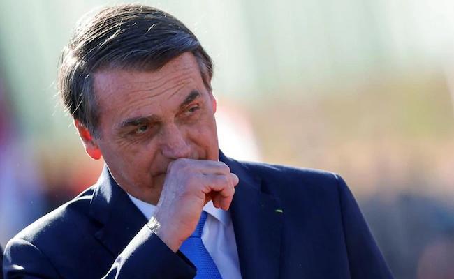 Wont take vaccine: Brazil president Bolsonaro - Sakshi