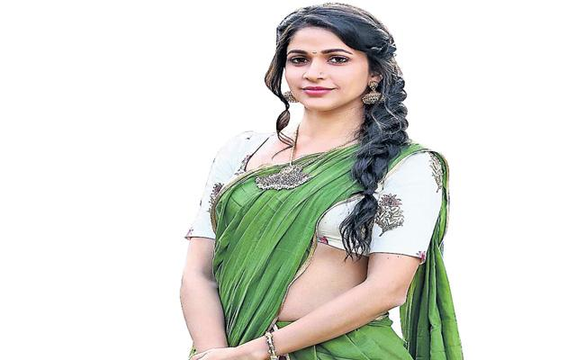 Lavanya Tripathi shows her back to liquor endorsements - Sakshi