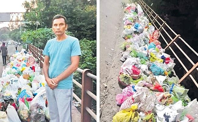 Chandra Kishor Patil Stops People Dump Garbage in Godavari River - Sakshi
