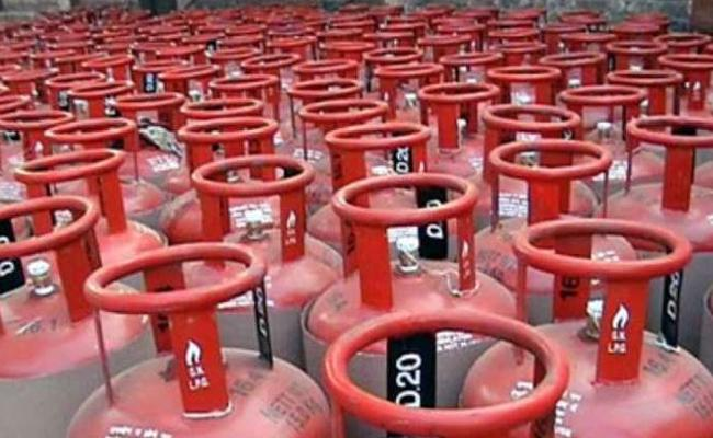 lpg gas price hiked in december - Sakshi