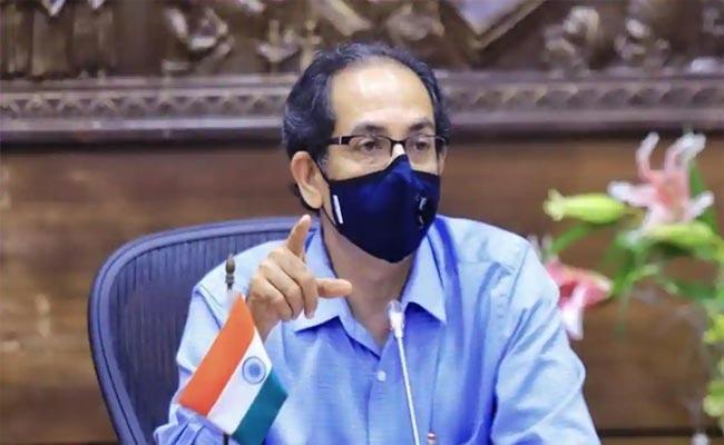 Wearing Of Masks Is Mandatory For Another 6 Moths Says Uddhav Thackeray - Sakshi