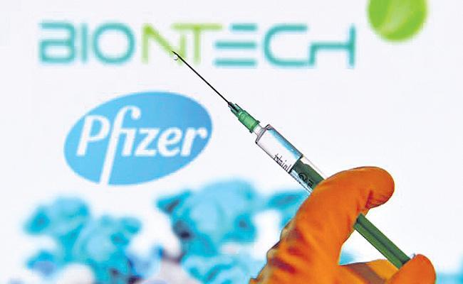 UK approves Pfizer-BioNTech vaccine for use - Sakshi