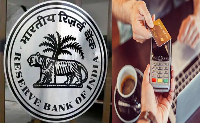 RBI hikes limits for contactless card transactions to rs 5000 - Sakshi