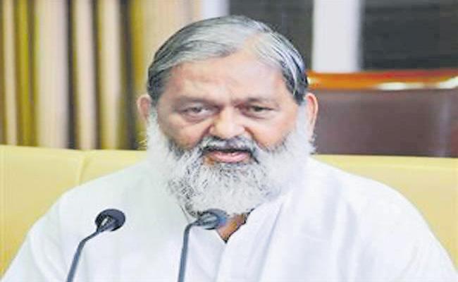 Haryana minister Anil vij tests positive after 1st Covaxin shot - Sakshi